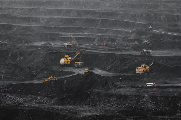 Open pit mine, coal loading in trucks, transportation and logistics