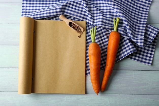 Open recipe book on wooden space