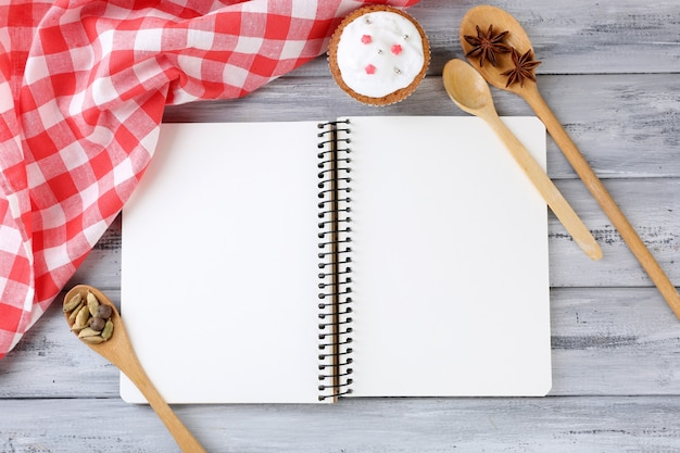 Open recipe book on wooden