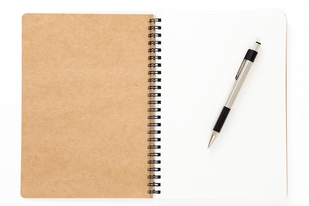 Open recycled ring binder notebook with pen
