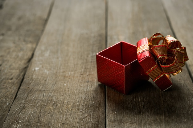 Open red christmas gift box on wood