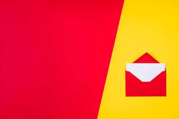 Open red envelope isolated on red and yellow