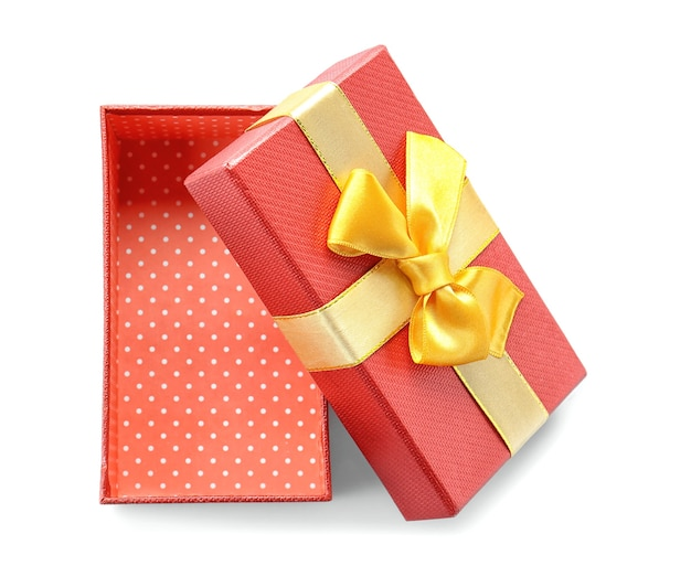 Open red gift box with golden ribbon