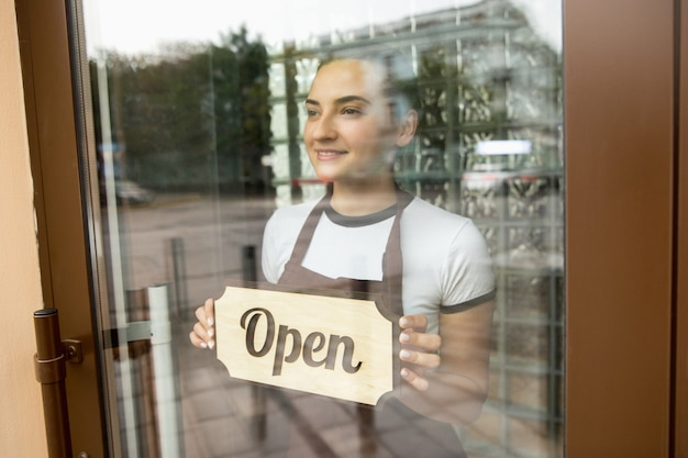 Open sign on the glass of street cafe or restaurant
