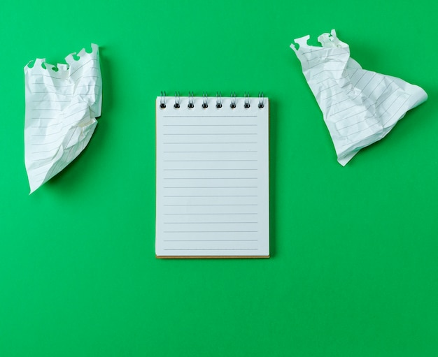 Open small blank notebook with white sheets