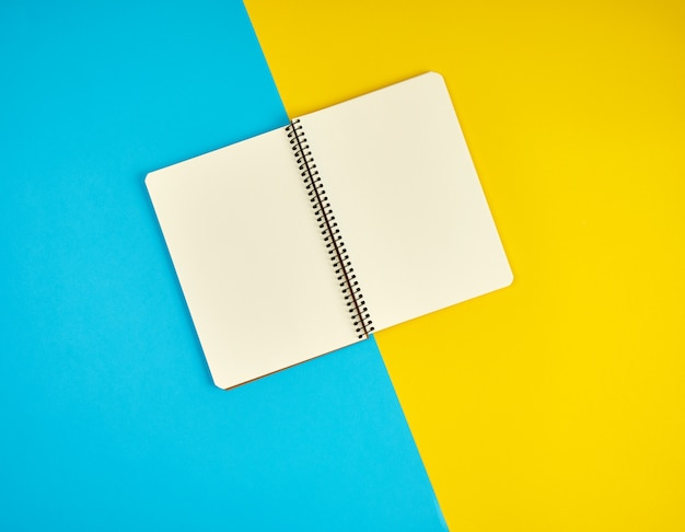 Open spiral notebook with blank white pages