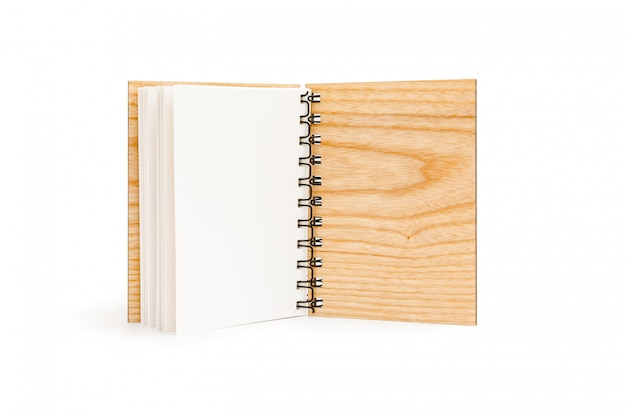 Open spiral notebook with solid wood cover isolated
