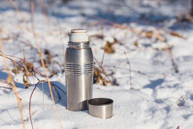 Open thermos with hot tea