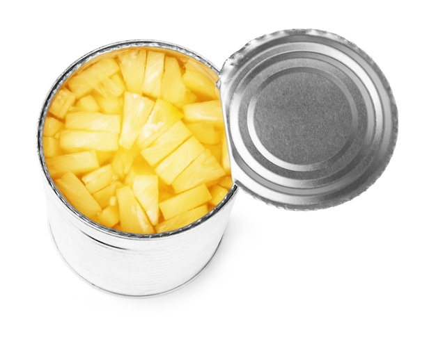 Open a tin of pineapples in syrup, isolated on white background