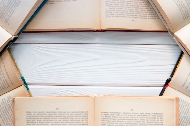 Open vintage book on white background with space for text