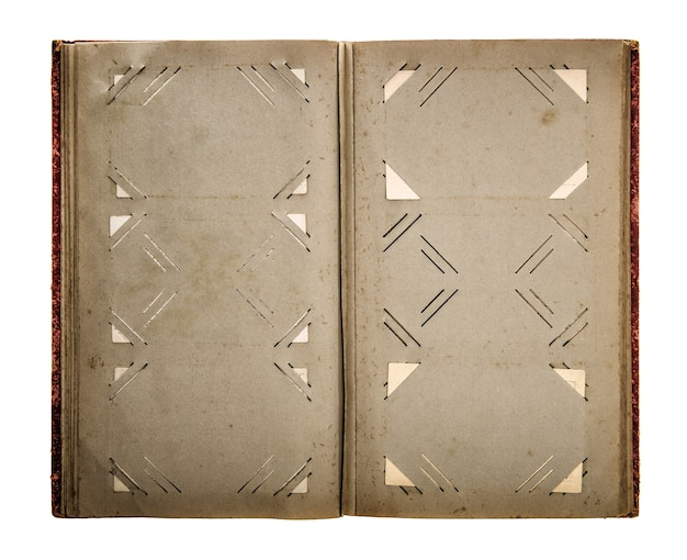 Open vintage photo album with dirty aged paper pages isolated on white background. retro style toned picture