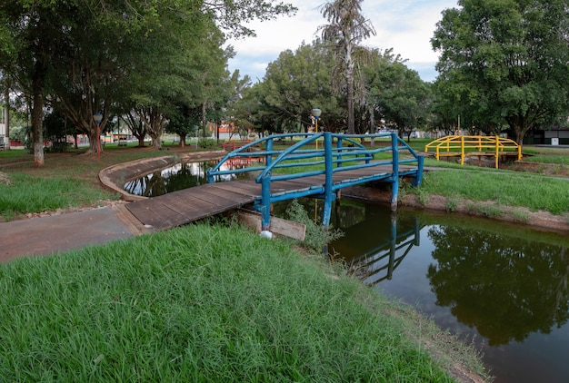 Open walking area square elza vendrame with green vegetation
