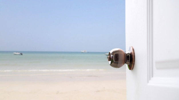 Open white door seaside .