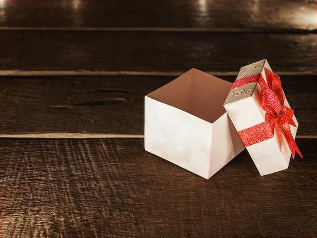 Open white gift box on wood desk