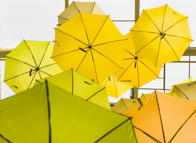 Open yellow umbrellas used as decoration
