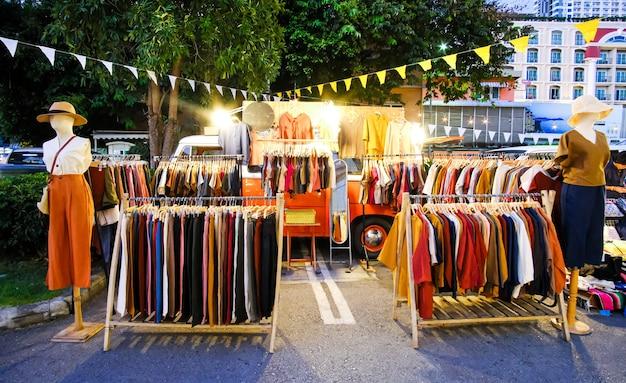 An openair clothing market at night