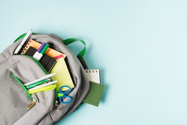 Opened backpack with school supplies