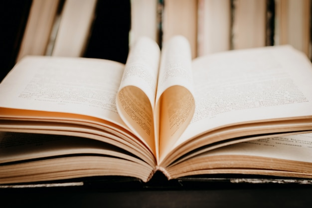 Opened book with heart shaped page. heart from book page, valentine's day