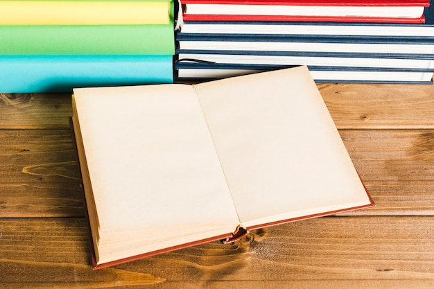 Opened book on wooden table