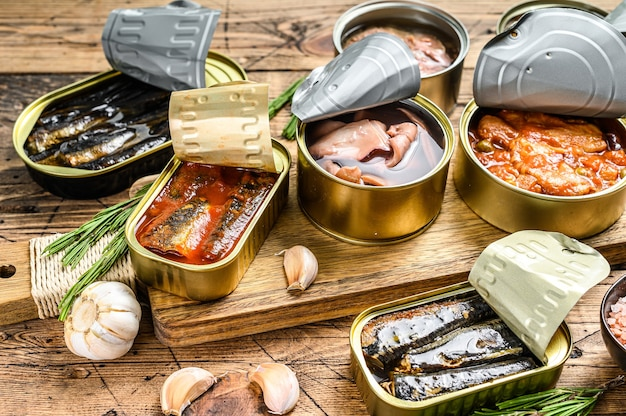 Opened cans conserve with saury, salmon, sprats, sardines, squid and tuna