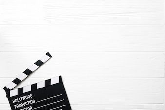 Opened clapperboard on white table