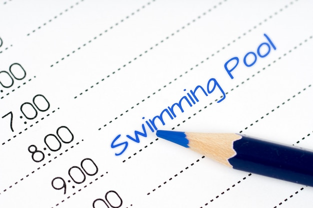 Opened day schedule with blue text swimming pool