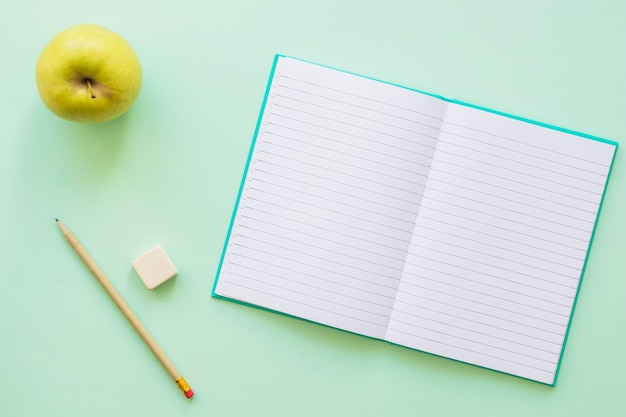 Opened diary with apple pencil and rubber