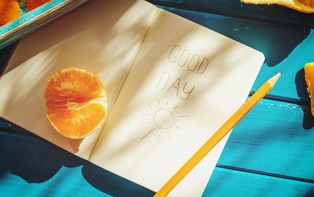 Opened diary with a pencil on a table.