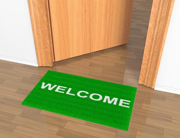 床にウェルカムラグが付いたドアを開けた