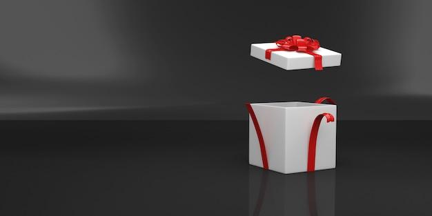 Opened empty gift box on black studio background