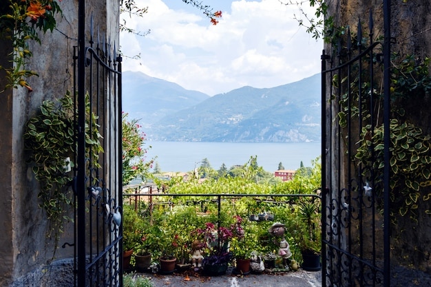 Opened gates with view to lake como