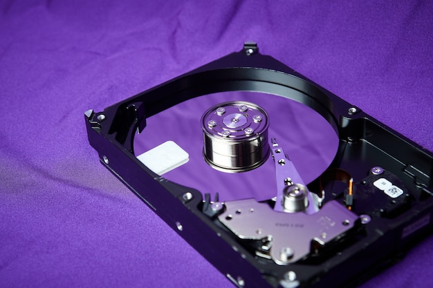 Opened hard drive from the computer hdd disk drive