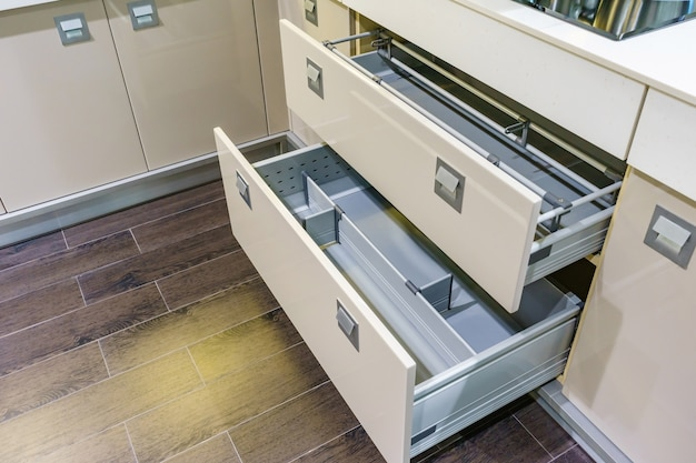 Opened kitchen drawer with plates inside, a smart solution for kitchen storage