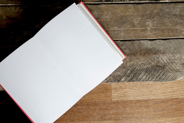 Opened notebook on lumber background