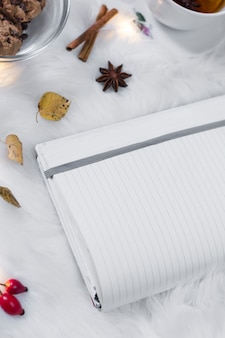 Opened notebook on white cover with decorations