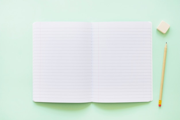 Opened notebook with pen and rubber