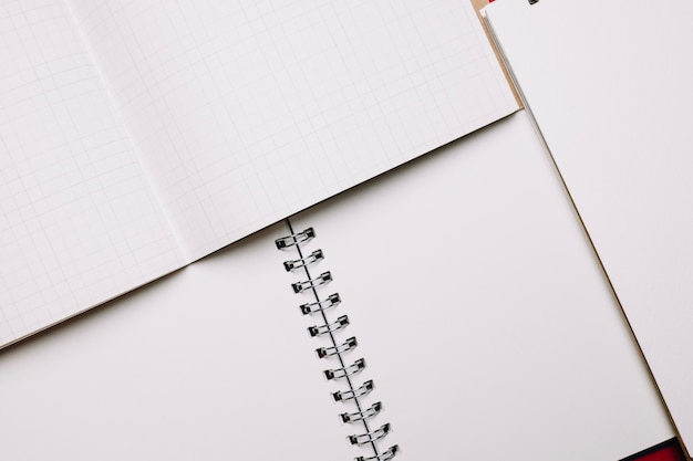 Opened notebooks with white pages
