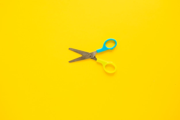 Opened scissors laid in middle