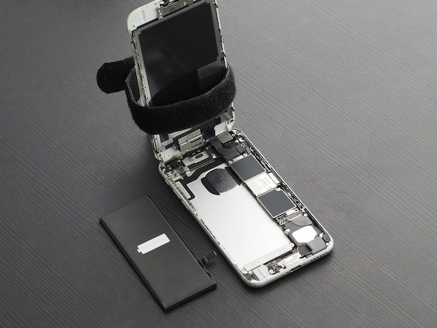 Opened smartphone, with new battery.