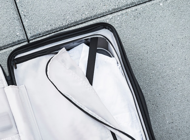Opened suitcase with white shirt