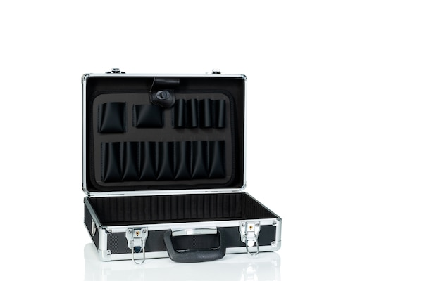 Opened toolbox isolated on white. silver aluminium and black plastic suitcase.