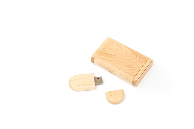Opened usb flash drive in a wooden case next to a gift wooden box.