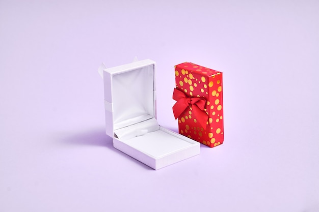 Opened white empty ring box and golden red box. proposal in christmas. valentines day jewelry