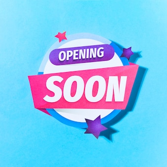 Opening soon text with stars on blue background