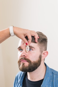 Ophthalmologist examines patient's eyes.