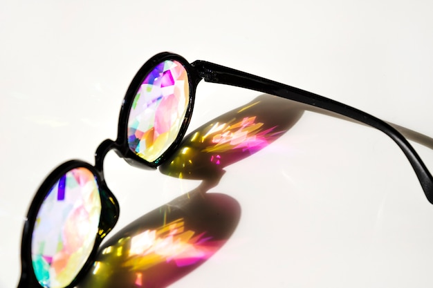 Optical eyeglasses prism refracting shadow on white background