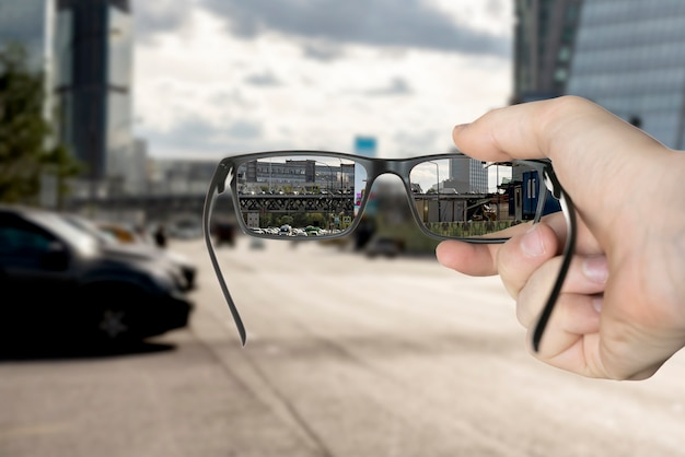 An optical eyevision concept, frame of eyeglasses show focused image on the blurred background