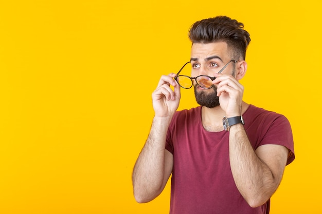 Optics, vision and style concept - take off put on glasses