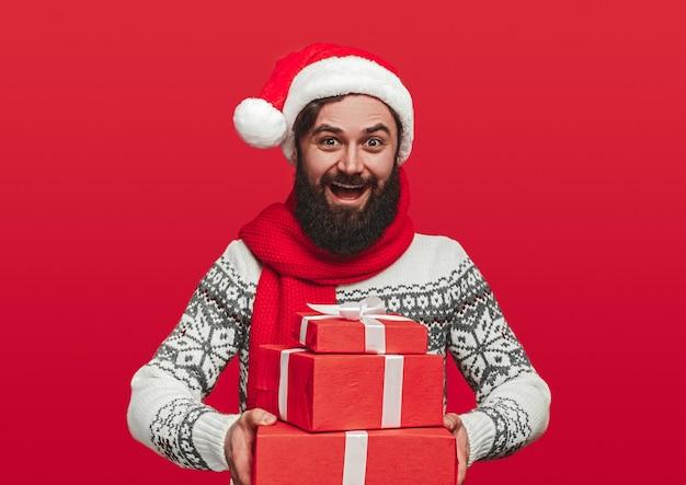 Optimistic bearded male in santa hat