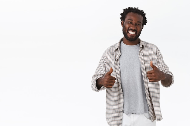 Optimistic, cheerful young handsome african american guy approve your awesome choice